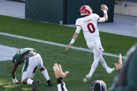 Rutgers quarterback Noah Vedral (0) runs into the end zone for a 24-yard touchdown during the first half of an NCAA college football game against Michigan State, Saturday, Oct. 24, 2020, in East Lansing, Mich. (AP Photo/Carlos Osorio)