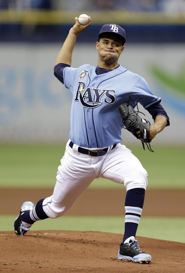 Tampa Bay Rays starting pitcher Chris Archer delivers to the Boston Red Sox during the first inning of a baseball game Sunday, July 27, 2014, in St. Petersburg, Fla. (AP Photo/Chris O'Meara)