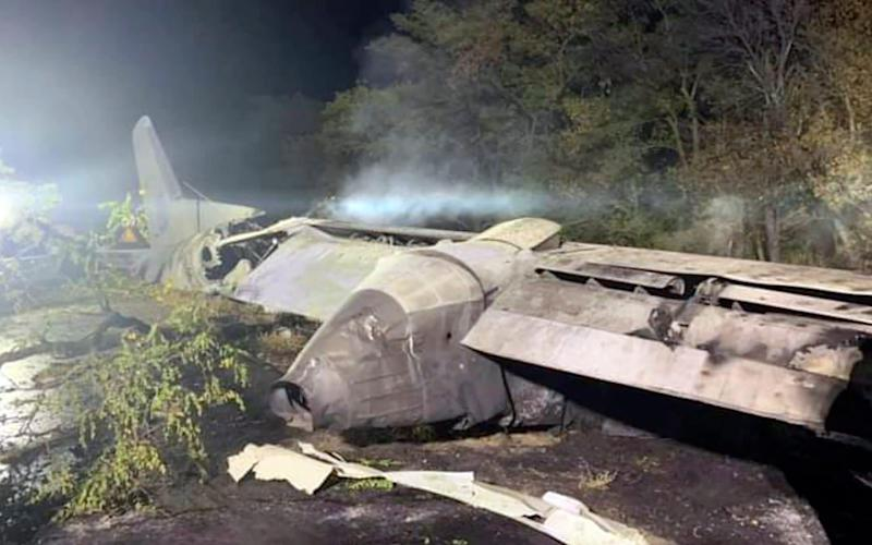 The wreckage of an AN-26 military plane after it crashed in the town of Chuguyiv - Kharkiv Regional State Administration via AP