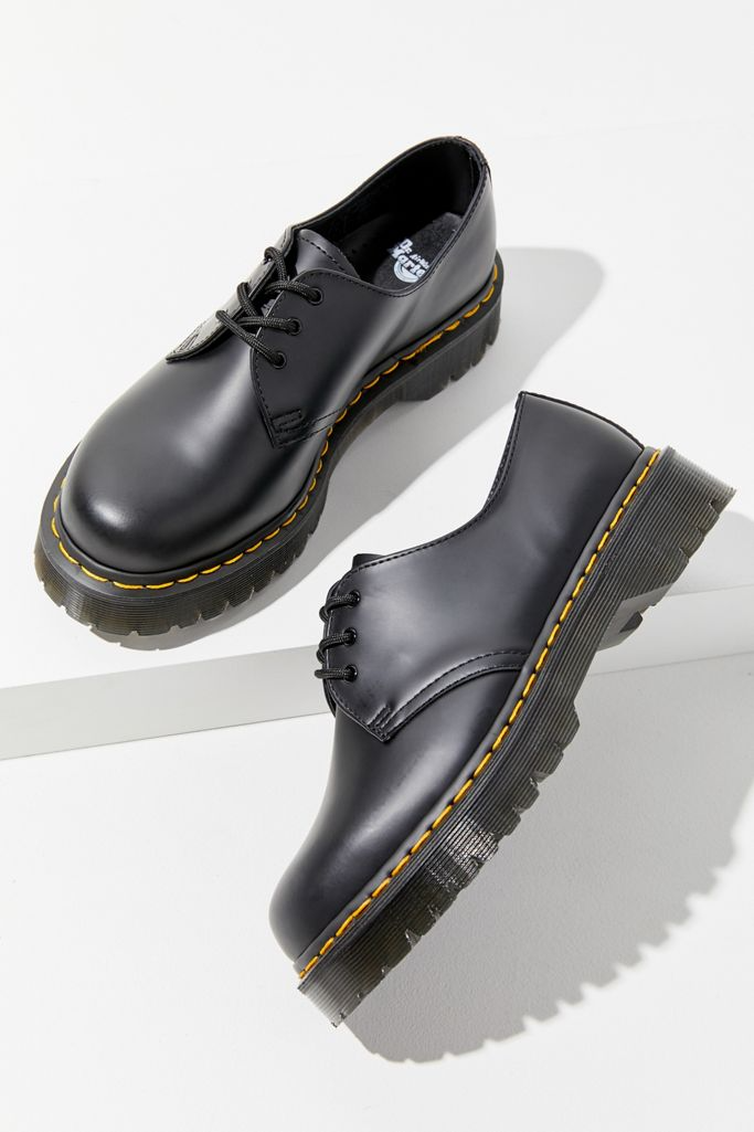 """<strong><h3>Dr. Marten 1461 Bex Oxford</h3></strong><br><strong>Why It's A Best Buy</strong>: A substantial oxford or loafer is without a doubt a footwear staple. These Docs have just the right tread to be a year-round all-weather shoe and are the perfect accessory to add a classic edge to any outfit. <br><br><strong>The Review</strong>: """"I've had the same pair of oxfords for about 4 years and they are absolutely my most worn shoe. They hold up super well in rain and snow, and I love to pair them with shorts or skirts in the summer. I've worn them so much that they feel like slippers and I can confidently walk in them for hours."""" – <em>Kate Spencer, Refinery29 Creative & Updates Editor</em><br><br><strong>Dr. Martens</strong> 1461 Bex Oxford, $, available at <a href=""""https://go.skimresources.com/?id=30283X879131&url=https%3A%2F%2Fwww.urbanoutfitters.com%2Fshop%2Fdr-martens-1461-bex-oxford"""" rel=""""nofollow noopener"""" target=""""_blank"""" data-ylk=""""slk:Urban Outfitters"""" class=""""link rapid-noclick-resp"""">Urban Outfitters</a>"""