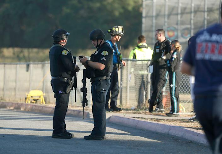Emergency personnel stand outside Gilroy High School following a deadly shooting at the Gilroy Garlic Festival in California on July 28, 2019.