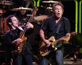 "FILE - Bruce Springsteen, right, and Nils Lofgren of the E Street Band perform during their concert at the Los Angeles Sports Arena on Oct. 29, 2007. Springsteen's latest album, ""Letter To You"" will be released on Oct. 23. (AP Photo/Chris Pizzello, File)"
