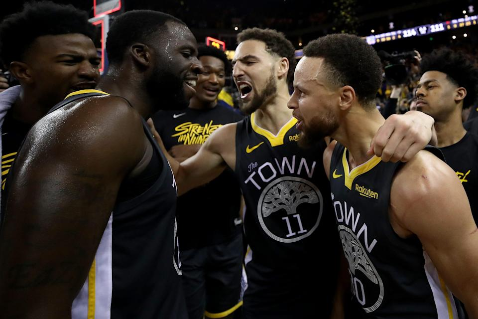 With Klay Thompson (11) returning after missing the past two seasons, the Warriors' trio of Thompson, Stephen Curry (right) and Draymond Green are expected to have them return as a contender in the West.