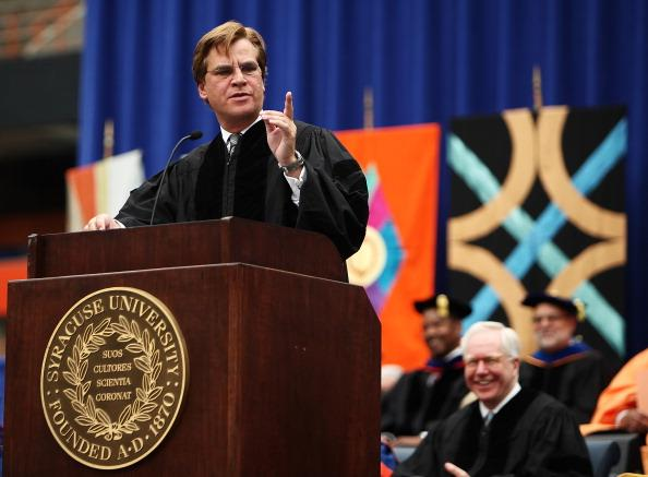 Aaron Sorkin, screenwriter, producer and playwright, points as he looks to the crowd during his address at the 2012 Syracuse University Commencement at Syracuse University on May 13, 2012 at the Carrier Dome in Syracuse, New York. (Photo by Nate Shron/Getty Images)