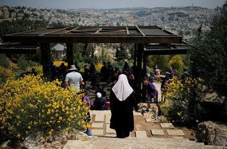 Palestinian visitors gather at a look-out point on the Armon Hanatziv Promenade in Jerusalem May 11, 2017. Picture taken May 11, 2017. REUTERS/Amir Cohen