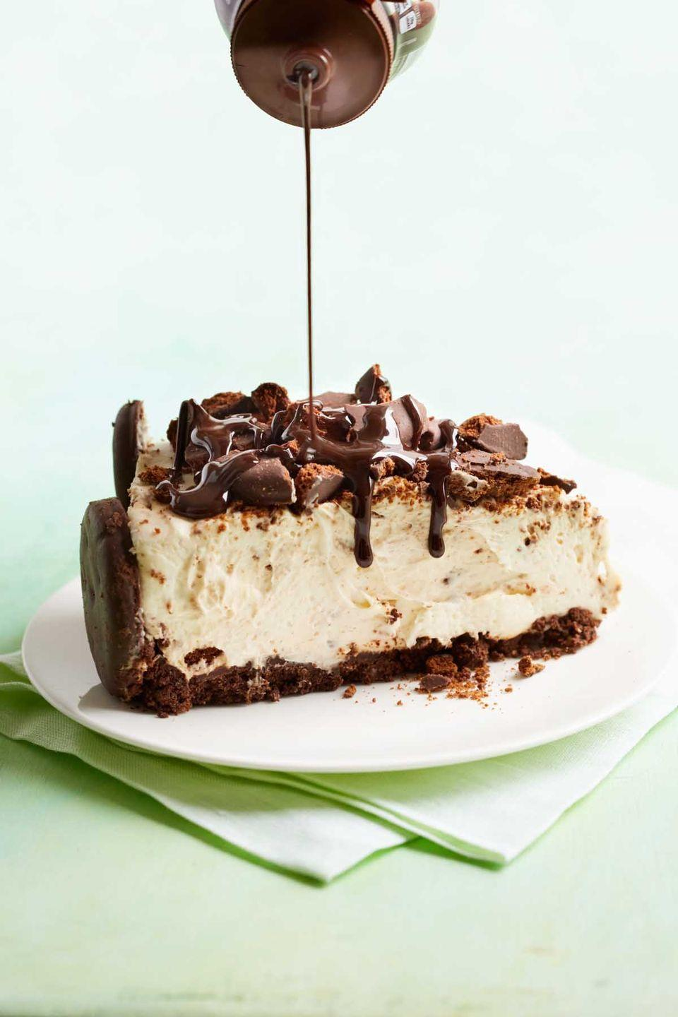 """<p>Surprise your mom with this one-of-a-kind cheesecake, which features everyone's favorite Girl Scout cookie. </p><p><a href=""""https://www.womansday.com/food-recipes/recipes/a57465/thin-mint-cheesecake-recipe/"""" rel=""""nofollow noopener"""" target=""""_blank"""" data-ylk=""""slk:Get the recipe for Thin Mint Cheesecake."""" class=""""link rapid-noclick-resp""""><em>Get the recipe for Thin Mint Cheesecake.</em></a><br></p>"""