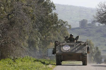 An Israeli soldier rides an armoured military ambulance Israel's border with Lebanon January 28, 2015. REUTERS/Baz Ratner