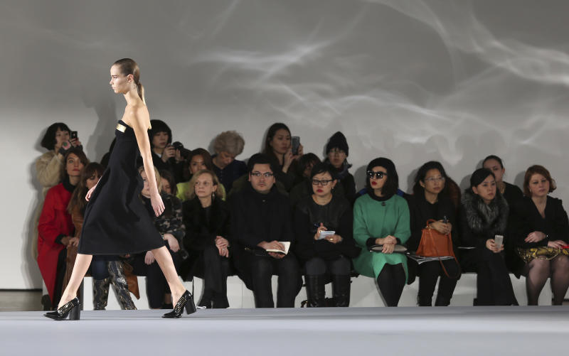 A model wears a creation for Jil Sander women's Fall-Winter 2013-14 collection, part of the Milan Fashion Week, unveiled in Milan, Italy, Saturday, Feb. 23, 2013. (AP Photo/Antonio Calanni)