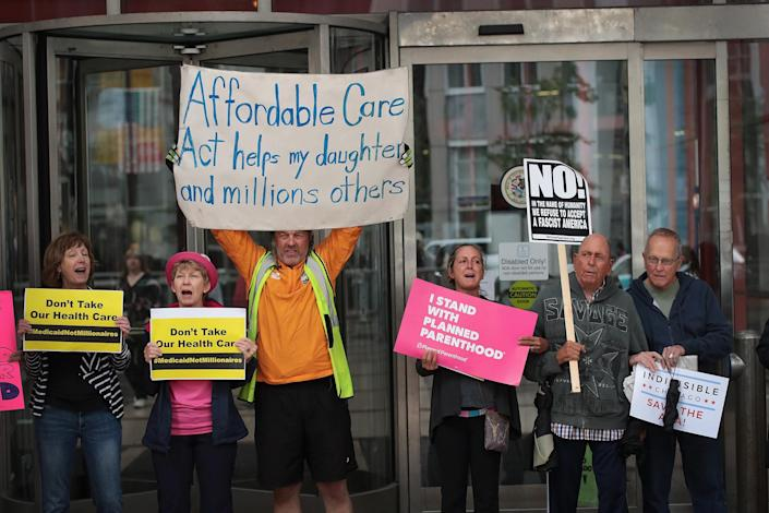 <p>Demonstrators protest changes to the Affordable Care Act on June 28, 2017 in Chicago, Illinois. After more senators said they would not offer support, senate Republican's yesterday announced they would delay a vote on their revised health-care bill. (Photo: Scott Olson/Getty Images) </p>