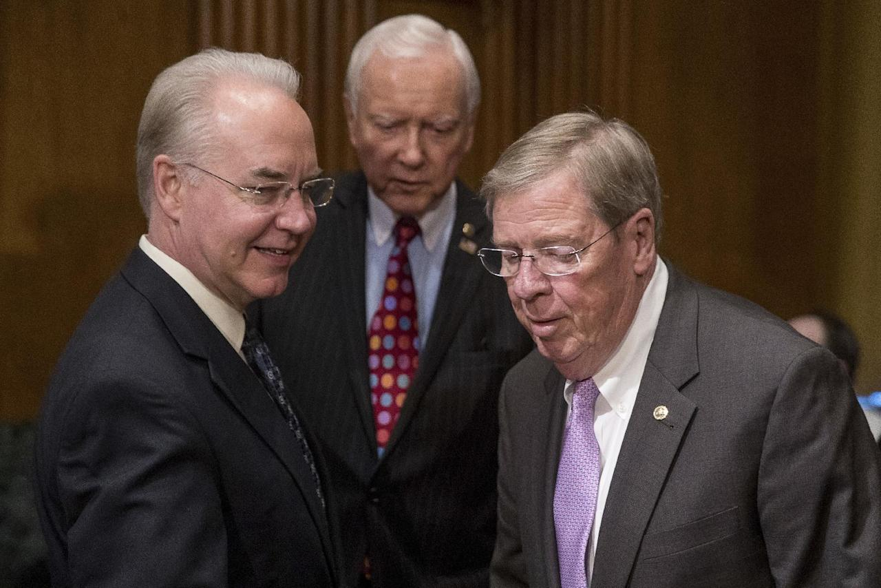 Health and Human Services Secretary-designate, Rep. Tom Price, R-Ga., left, arrives with Senate Finance Committee Chairman Sen. Orrin Hatch, R-Utah, center, and Sen. Johnny Isakson, R-Ga., on Capitol Hill in Washington, Tuesday, Jan. 24, 2017, before the start of his confirmation hearing before the committee. (AP Photo/Andrew Harnik)