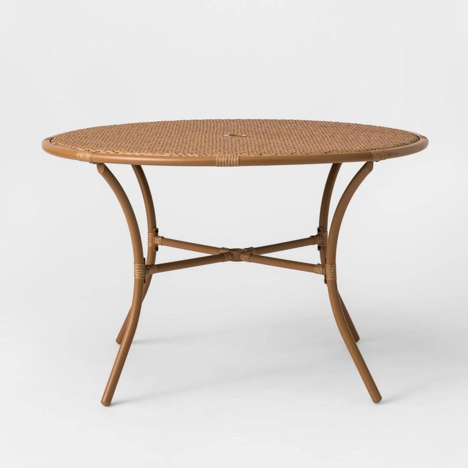<p>Sit back and enjoy the natural finish on the <span>Britanna Four-Person Patio Dining Table</span> ($250). The table's steel frame is completely weather resistant, while its woven finish blends with any look.</p>