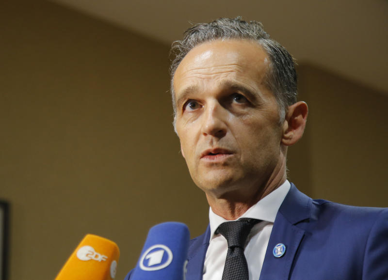 German Foreign Minister Heiko Maas, speaks to the media after a meeting on divisive migrant issue in Paris, France, July 22, 2109. European ministers are meeting in Paris in a new step to find an accord on the divisive issue of how to deal with migrants crossing the Mediterranean but, shut out by Italy and unwanted elsewhere, caught in political standoffs. (AP Photo/Michel Euler)