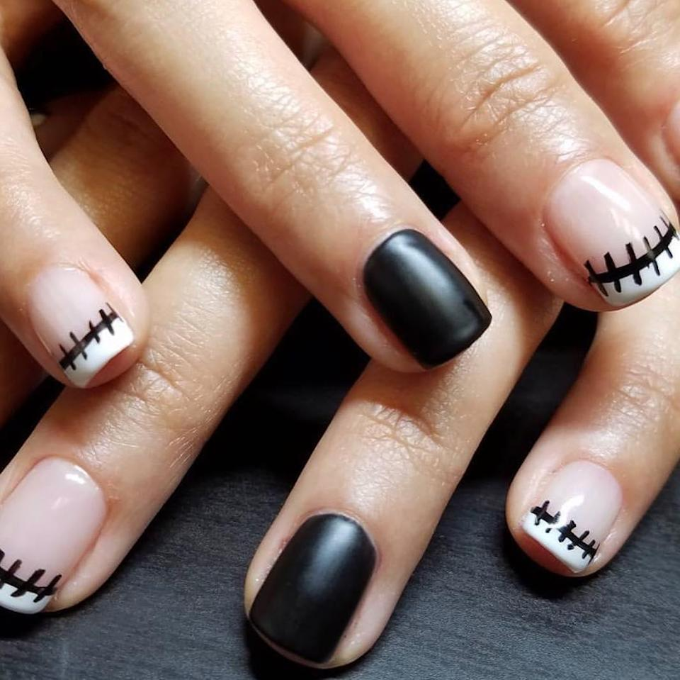 """Sally from the <em>The Nightmare Before Christmas</em> is a <a href=""""https://www.glamour.com/story/halloween-makeup-ideas-from-pinterest?mbid=synd_yahoo_rss"""" rel=""""nofollow noopener"""" target=""""_blank"""" data-ylk=""""slk:top-searched costume on Pinterest"""" class=""""link rapid-noclick-resp"""">top-searched costume on Pinterest</a> year after year. Here's a mani to make the look complete."""
