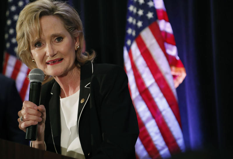 FILE - In this Nov. 27, 2018 file photo, Republican U.S. Sen. Cindy Hyde-Smith speaks to her supporters as she celebrates her runoff win over Democrat Mike Espy in Jackson, Miss. On Tuesday, Nov. 12, 2019, Espy announced another run for U.S. Senate, setting up a 2020 rematch with Hyde-Smith. (AP Photo/Rogelio V. Solis, File)