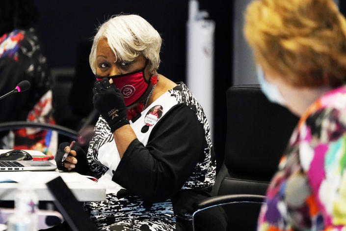 Virginia State Sen. Louise Lucas, D-Portsmouth, adjusts her mask as she chairs a committee hearing in Richmond on Aug. 19, 2020. (Steve Helber / AP file)