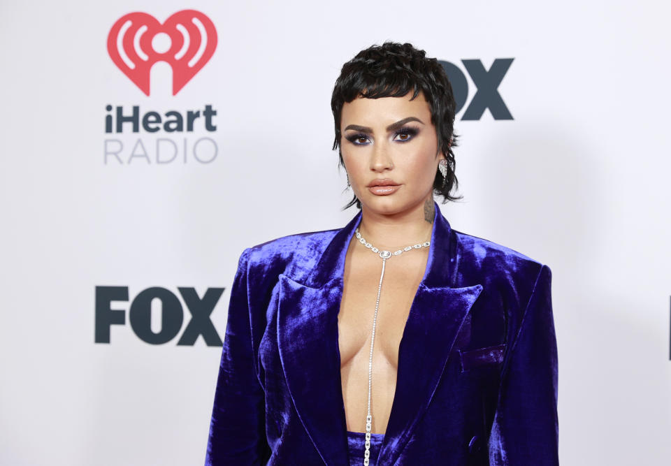 Demi Lovato explains the reason they cut off all their hair. (Photo: Getty Images)