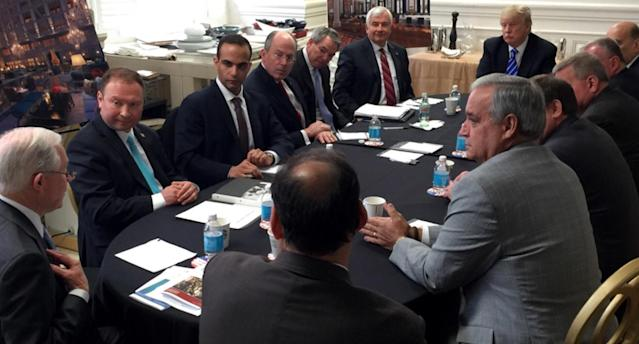 In this photo from Donald Trump's Twitter account, George Papadopoulos, third from left, sits at a table with then-candidate Trump and others at what is labeled at a national security meeting in Washington that was posted on March 31, 2016. (Photo via AP)