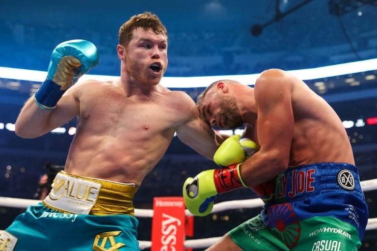 """Saul """"Canelo"""" Alvarez lands a big left-hand on Billy Joe Saunders during their super middleweight title fight in Arlington in fromt of a record 70,000-plus fans"""