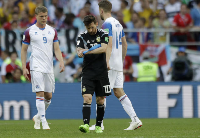 Argentina's Lionel Messi takes off the captain's armband after a draw during the group D match between Argentina and Iceland at the 2018 soccer World Cup in the Spartak Stadium in Moscow, Russia, Saturday, June 16, 2018. (AP Photo/Matthias Schrader)