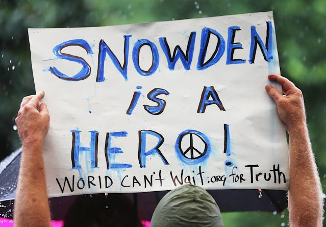 NEW YORK, NY - JUNE 10: A supporter holds a sign at a small rally in support of National Security Administration (NSA) whistleblower Edward Snowden in Manhattan's Union Square on June 10, 2013 in New York City. About 15 supporters attended the rally a day after Snowden's identity was revealed in the leak of the existence of NSA data mining operations. (Photo by Mario Tama/Getty Images)