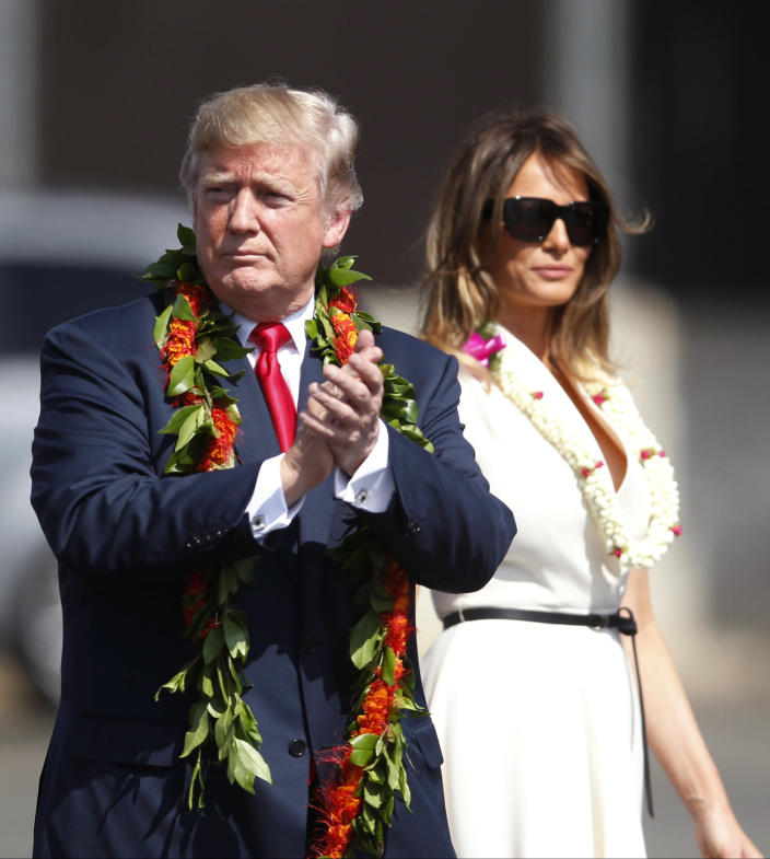 <p>Adorned with lei, President Donald Trump walks with first lady Melania Trump to meet servicemen, Friday, Nov. 3, 2017 at Joint Base Pearl Harbor Hickam in Honolulu. (Jamm Aquino/The Star-Advertiser via AP) </p>