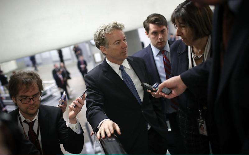 Rand Paul speaks to reporters on his way to the floor of the US Senate - Getty Images North America