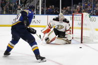 Anaheim Ducks goaltender John Gibson, right, deflects puck as St. Louis Blues' Alexander Steen, left, watches during the second period of an NHL hockey game Monday, Jan. 13, 2020, in St. Louis. (AP Photo/Jeff Roberson)