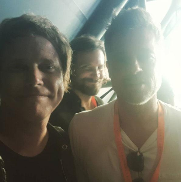 Brad posed for a selfwith witth singer Chris Simmons... and was photobombed by Bradley Cooper! Source: Instagram