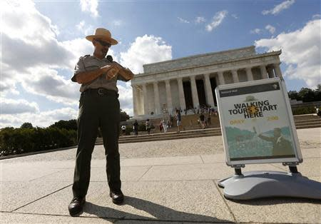 U.S. National Park Ranger Mark Ragan checks his watch while on duty in front of the Lincoln Memorial in Washington