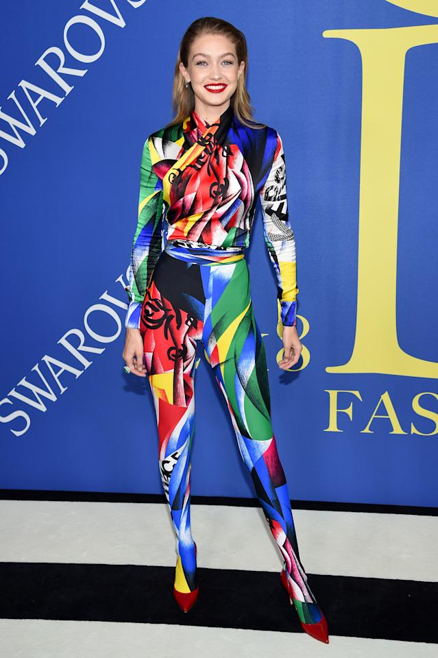 <p>While many celebs opted for neutral hues, model Gigi drew attention with a bright, coloured jumpsuit. <br />Source: Getty </p>