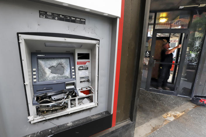 A damaged ATM machine outside a KeyBank branch in downtown Pittsburgh on Sunday, May 31, 2020. Along with the damaged ATM, windows were broken during a march in Pittsburgh, Saturday to protest the death of George Floyd, who died after being restrained by Minneapolis police officers on Memorial Day, May 25. (AP Photo/Gene J. Puskar)