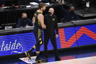 Indiana Pacers forward Domantas Sabonis (11) shakes hands with coach Nate Bjorkgren, right, after fouling out during the second half of the team's NBA basketball Eastern Conference play-in game against the Washington Wizards, Thursday, May 20, 2021, in Washington. (AP Photo/Nick Wass)