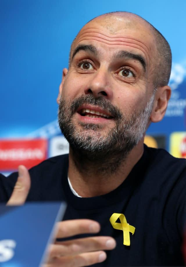 Pep Guardiola wearing a yellow ribbon in support of Catalan independence (Martin Rickett/PA)