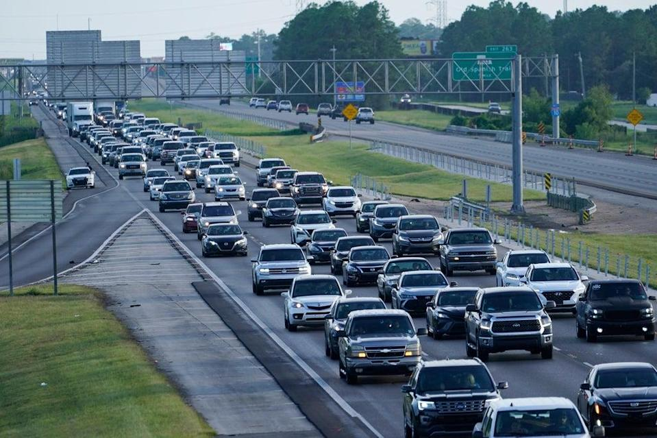 Heavy traffic clogs Interstate 10 out of New Orleans as residents and visitors evacuate for the expected arrival of Hurricane Ida (AP)