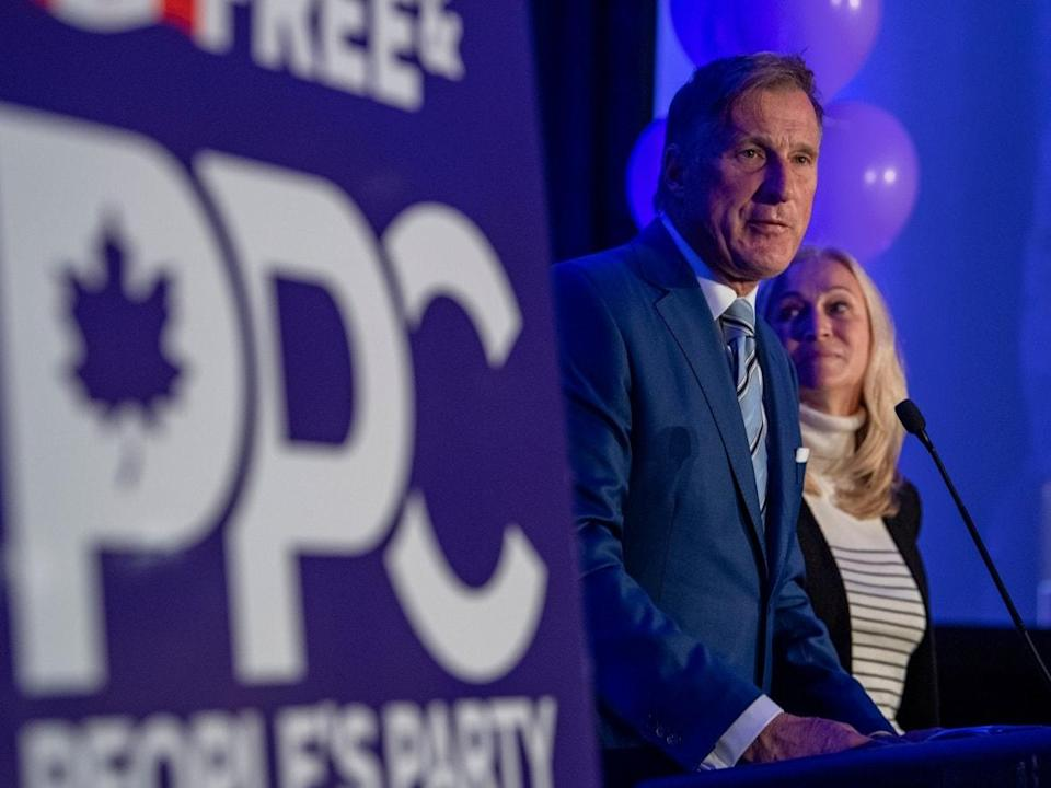 People's Party of Canada Leader Maxime Bernier, with his wife, Catherine Letarte, speaks at the PPC headquarters in Saskatoon on election night. Just over 844,000 Canadians voted for the party. (Liam Richards/The Canadian Press - image credit)