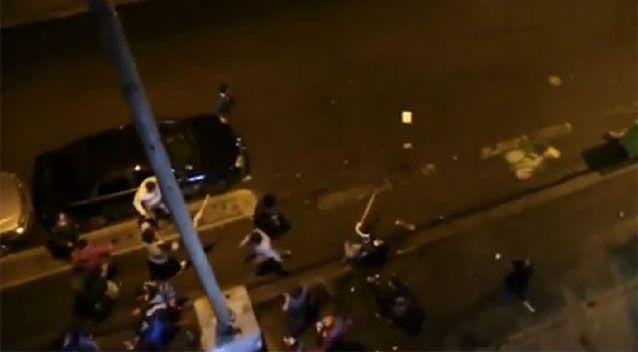 Police dispersed the violence by throwing tear gas at the melee.  Source: Youtube/ Arnault CHENE