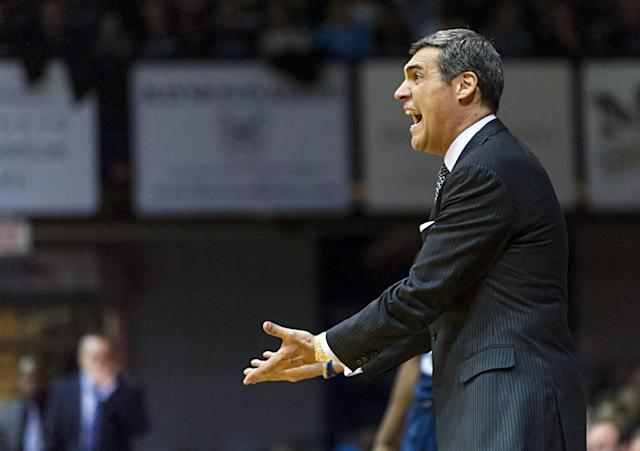 Villanova head coach Jay Wright reacts to a call on the floor in the first half of an NCAA college basketball game, Tuesday, Dec. 31, 2013, in Indianapolis. (AP Photo/Doug McSchooler)
