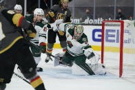 Vegas Golden Knights left wing Max Pacioretty, left, scores on Minnesota Wild goaltender Cam Talbot (33) during the second period of an NHL hockey game Monday, March 1, 2021, in Las Vegas. (AP Photo/John Locher)