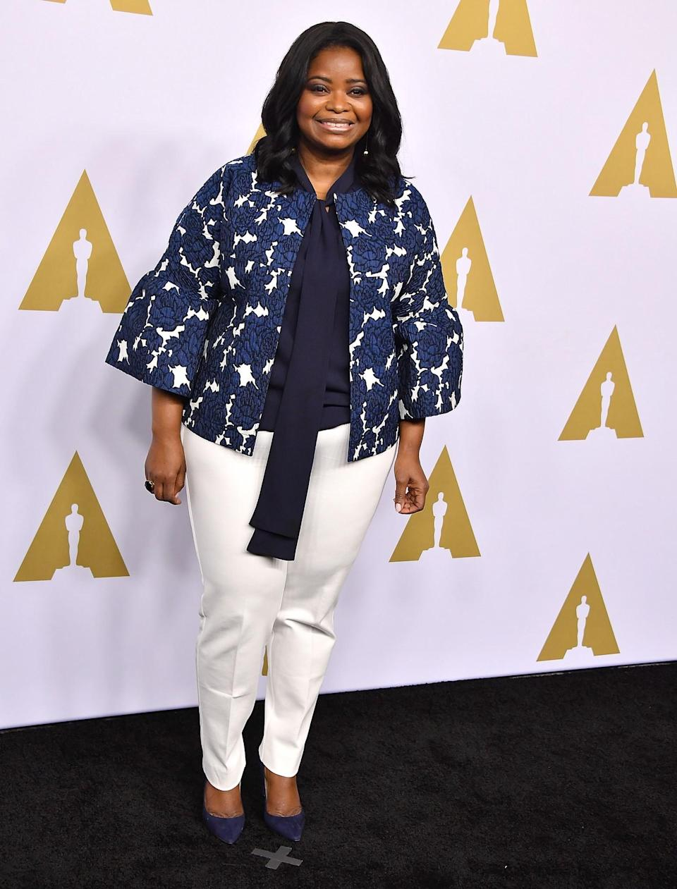 <p>Octavia stunned in a floral bell sleeved jacket and white trousers. [Photo: Getty] </p>