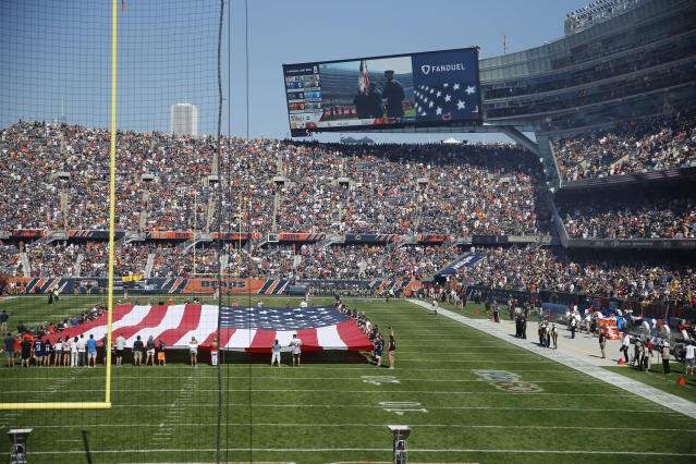 <p>Fans watch the unfurled U.S flag on the field during the playing of the national anthem before an NFL football game between the Chicago Bears and Pittsburgh Steelers, Sunday, Sept. 24, 2017, in Chicago. The Pittsburgh Steelers players did not come out to the field during the anthem. (AP Photo/Charles Rex Arbogast) </p>