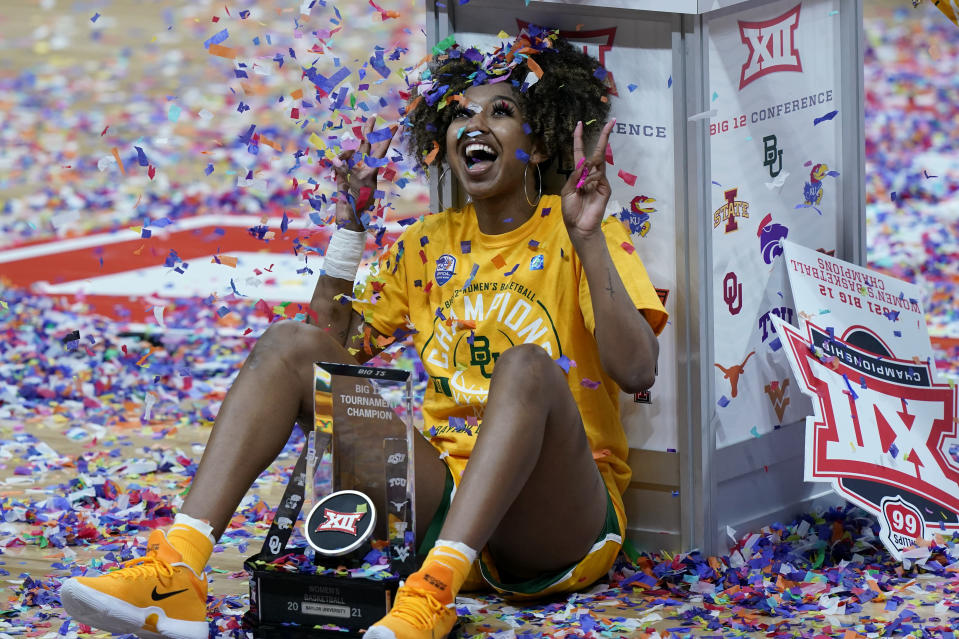 Baylor's DiDi Richards celebrates after winning an NCAA college basketball game against West Virginia in the final round of the Big 12 Conference tournament in Kansas City, Mo, Sunday, March 14, 2021. (AP Photo/Charlie Riedel)