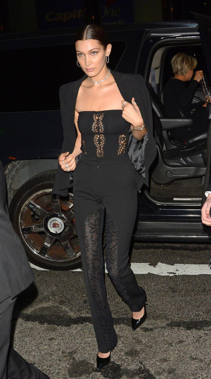 <p>In a black strapless jumpsuit with lace panels, a black blazer, patent leather pumps, a diamond necklace, hoop earrings and layered silver rings while out in NYC.</p>