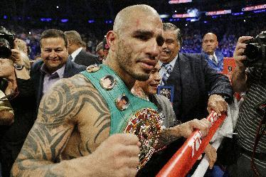 Middleweight champ Miguel Cotto, above, had a great year, but even he wants no part of Gennady Golovkin. (AP)