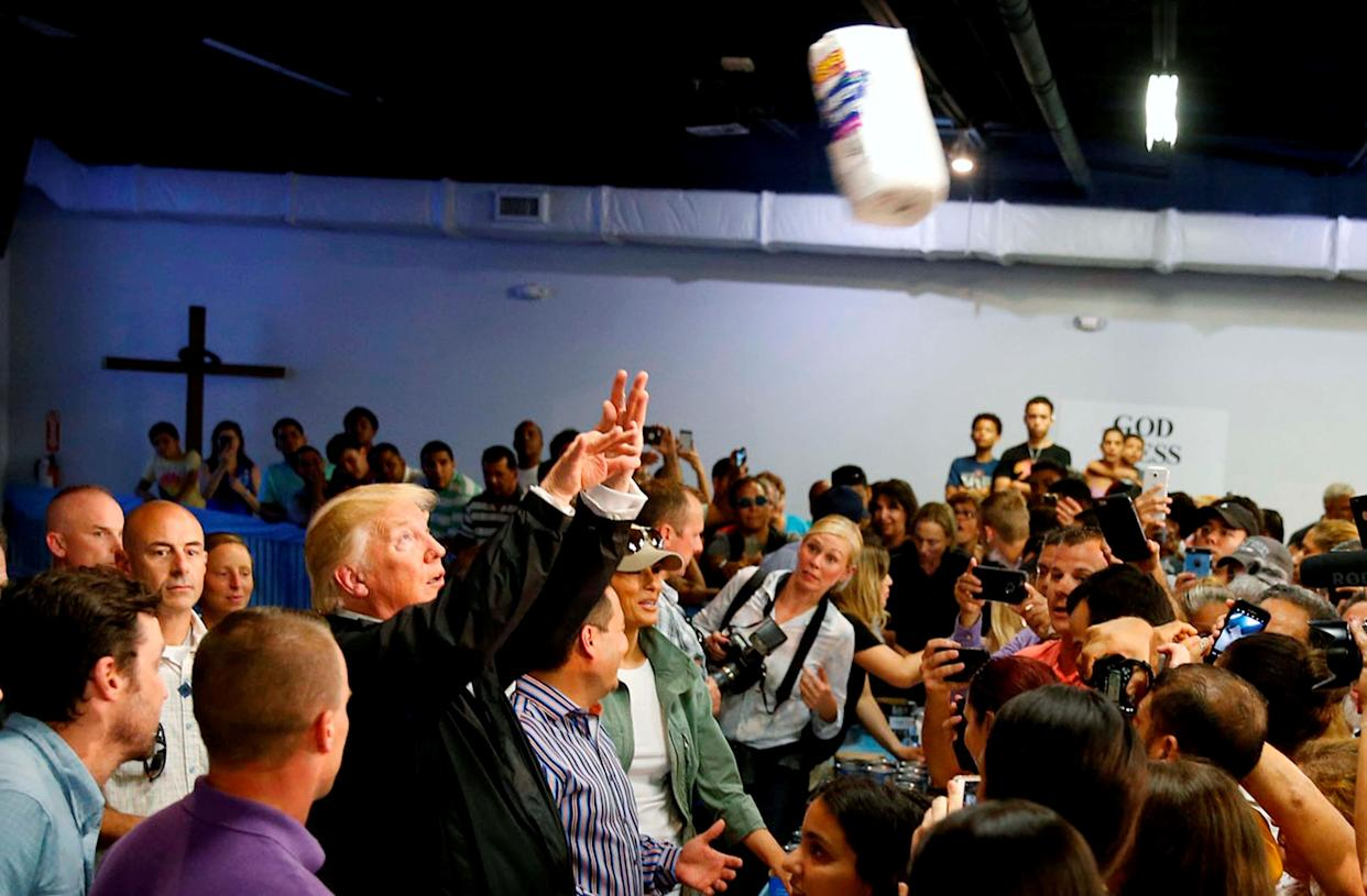 Trump throws rolls of paper towels into a crowd of Puerto Rico residentsaffected by Hurricane Maria as he visits Calgary Chapel in San Juan on Oct. 3.