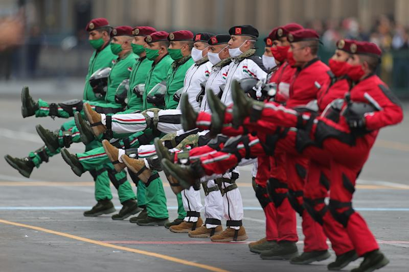 VARIOUS CITIES, MEXICO - SEPTEMBER 16: Parachuters of the Mexican army look up towards President Andrés Manuel López Obrador during the Independence Day military parade at Zocalo Square on September 16, 2020 in Various Cities, Mexico. This year El Zocalo remains closed for general public due to coronavirus restrictions. Every September 16 Mexico celebrates the beginning of the revolution uprising of 1810. (Photo by Hector Vivas/Getty Images)
