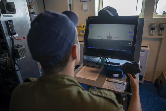 An Israeli Navy sailor looks at Israel's offshore Leviathan gas field on a computer screen, on board the Israeli Navy Ship Atzmaut, in the Mediterranean Sea, Wednesday, Sept. 1, 2021. One of the navy's most important responsibilities is protecting Israel's natural gas platforms in the Mediterranean Sea, which now provide some 75% of the country's electricity. (AP Photo/Ariel Schalit)