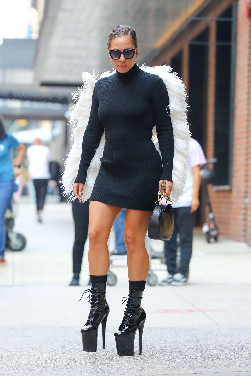 """<p>The multi-hyphenate kept her high fashion credentials while out in New York by stepping out in sky-high heels, a feather-winged mini dress and the 'Hobo Cat' handbag all by Lanvin.</p><p><a class=""""link rapid-noclick-resp"""" href=""""https://www.lanvin.com/gb/hobo-cat-bag-sm-in-lamb-leather-lw-bgshc1-napa-a2110.html"""" rel=""""nofollow noopener"""" target=""""_blank"""" data-ylk=""""slk:SHOP LADY GAGA'S HANDBAG NOW"""">SHOP LADY GAGA'S HANDBAG NOW</a></p>"""