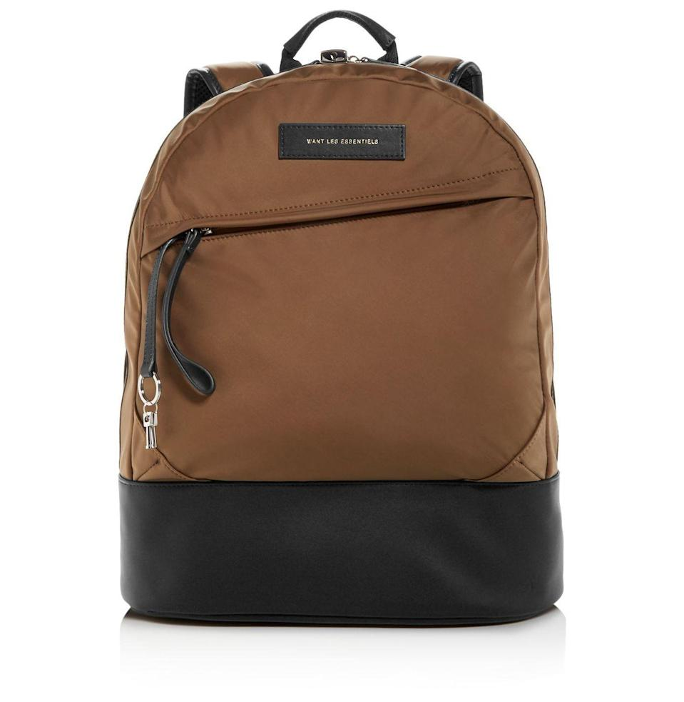 """<p><strong>WANT Les Essentiels</strong></p><p>bloomingdales.com</p><p><strong>$371.25</strong></p><p><a href=""""https://go.redirectingat.com?id=74968X1596630&url=https%3A%2F%2Fwww.bloomingdales.com%2Fshop%2Fproduct%2Fwant-les-essentiels-kastrup-nylon-backpack%3FID%3D3391550&sref=https%3A%2F%2Fwww.esquire.com%2Flifestyle%2Fg32840601%2Fbest-stepdad-gifts%2F"""" rel=""""nofollow noopener"""" target=""""_blank"""" data-ylk=""""slk:Buy"""" class=""""link rapid-noclick-resp"""">Buy</a></p><p>The sagging briefcase, decrepit from years of use, can finally be set aside in favor of this nylon commuter backpack. It's a thing of beauty, with space for a laptop and plenty more.</p>"""