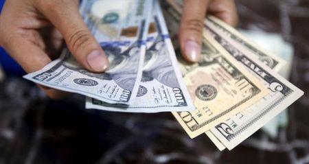 Dollar hovering near 5-month highs as Treasury yields support