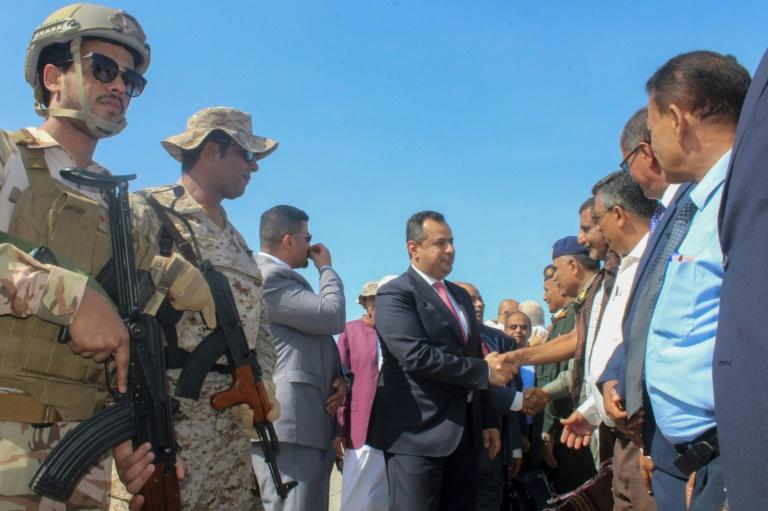 Yemen's Prime Minister Maeen Abdulmalik Saeed is greeted on flying back to Aden